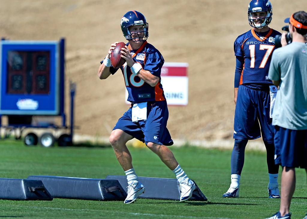 . ENGLEWOOD, CO - JUNE 02: Denver Broncos quarterback Peyton Manning (18) runs through drills during OTAs June 2, 2014 at Dove Valley. (Photo by John Leyba/The Denver Post)