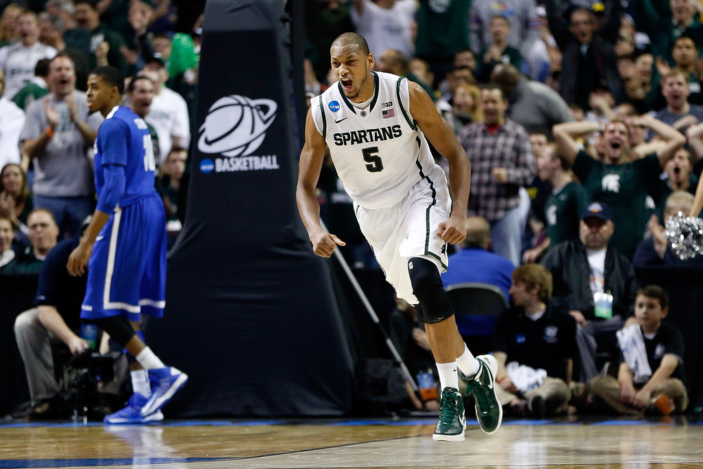 . AUBURN HILLS, MI - MARCH 23:  Adreian Payne #5 of the Michigan State Spartans celebrates in the second half against the Memphis Tigers during the third round of the 2013 NCAA Men\'s Basketball Tournament at The Palace of Auburn Hills on March 23, 2013 in Auburn Hills, Michigan.  (Photo by Gregory Shamus/Getty Images)