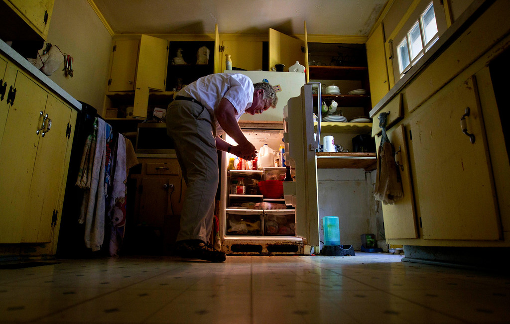 """. Roger Keeney, who took up blind baseball after losing his sight, pulls groceries from the refrigerator to prepare dinner for his family at his home in Athens, Ga. on April 9, 2012. \""""Blind folks can do nearly any job that you can do except for maybe drive down the road. It is hard for employers to believe that we can do the job. On paper, I\'m number one or number two every time I apply for anything. But as soon as I walk through the door of the the office to the interviewer with my white stick, you can feel the mood in the room change. You can physically feel the change. And the attitude is prevalent that this person can\'t do the job they\'ve applied for and so I don\'t get it.\"""" (AP Photo/David Goldman)"""