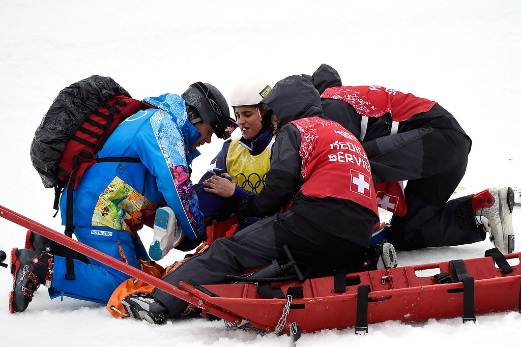 . Stephanie Joffroy of Chile is stretchered away after crashing in the Freestyle Skiing Womens\' Ski Cross Quarterfinals on day 14 of the 2014 Winter Olympics at Rosa Khutor Extreme Park on February 21, 2014 in Sochi, Russia.  (Photo by Lars Baron/Getty Images)