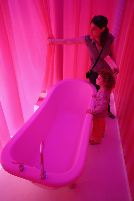 . Tamar, 4, and her mother Inbal, who are bother visiting from Israel, look at Barbie\'s bathtub at the Barbie Dreamhouse Experience on May 16, 2013 in Berlin, Germany. The Barbie Dreamhouse is a life-sized house full of Barbie fashion, furniture and accessories and will be open to the public until August 25 before it moves on to other cities in Europe.  (Photo by Sean Gallup/Getty Images)