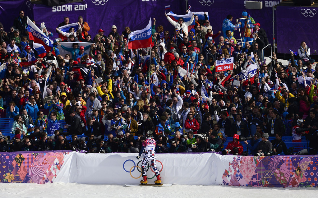 . The crowd cheers for Russia\'s Vic Wild in the Men\'s Snowboard Parallel Slalom Semifinals at the Rosa Khutor Extreme Park during the Sochi Winter Olympics on February 22, 2014.  JAVIER SORIANO/AFP/Getty Images