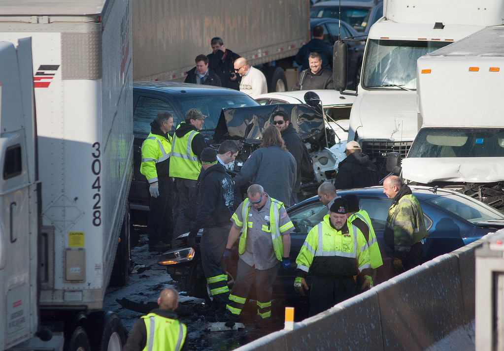 . Rescue and fire personnel assist on the scene of a 100 car chain reaction pileup accident on the Pennsylvania Turnpike eastbound February 14, 2014 in Feasterville, Pennsylvania.  (Photo by William Thomas Cain/Getty Images)