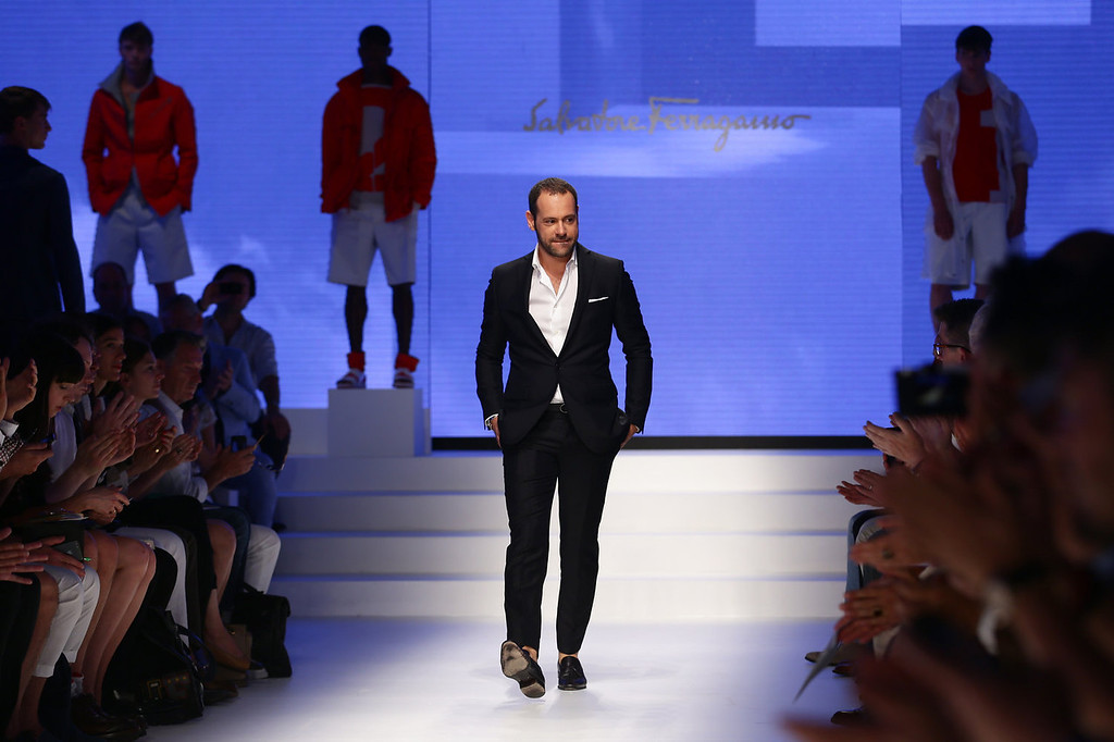 . Designer Massimiliano Giornetti acknowledges the audience at the Salvatore Ferragamo show during Milan Menswear Fashion Week Spring Summer 2014 on June 23, 2013 in Milan, Italy.  (Photo by Vittorio Zunino Celotto/Getty Images)
