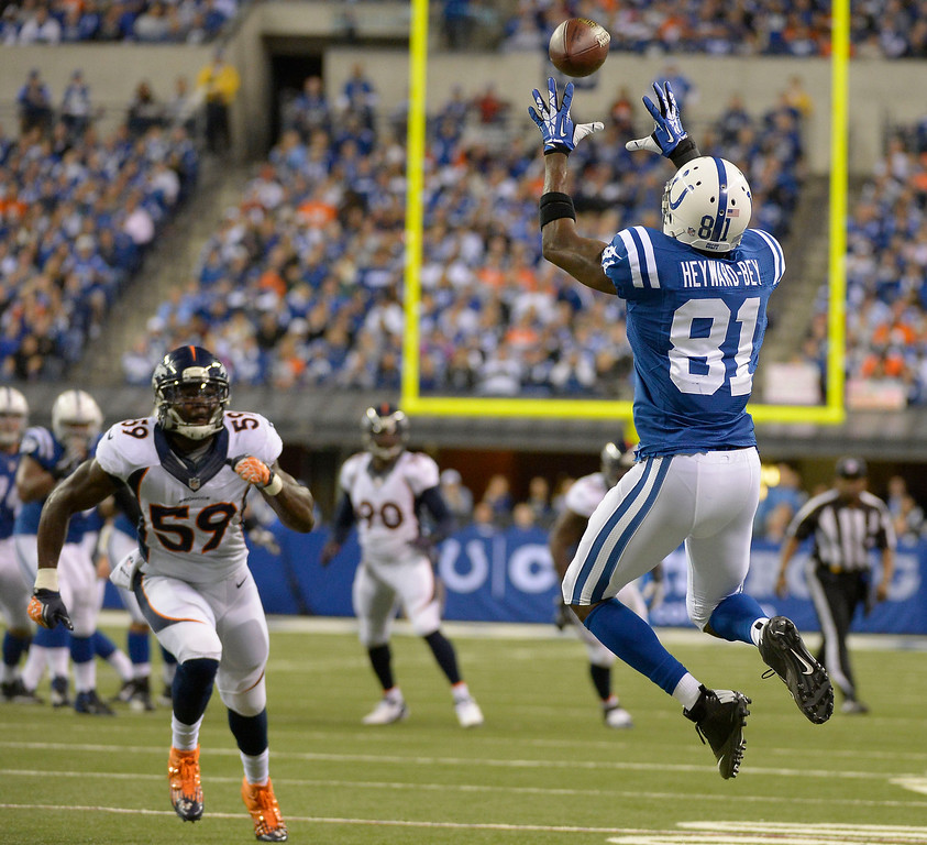 . Indianapolis Colts wide receiver Darrius Heyward-Bey (81) catches a pass as Denver Broncos outside linebacker Danny Trevathan (59) looks on during the first quarter October 20, 2013 at Lucas Oil Field. Photo by John Leyba/The Denver Post)