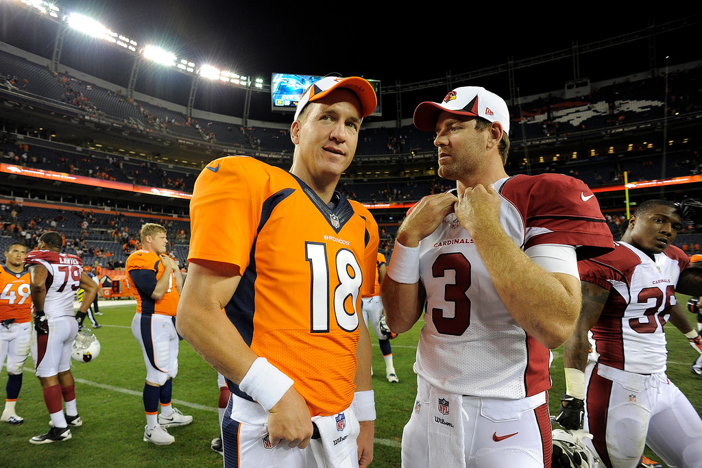 . Denver Broncos quarterback Peyton Manning (18) talks with Arizona Cardinals quarterback Carson Palmer (3) following the fourth quarter on August 29, 2013 at Sports Authority Field at Mile High. The Denver Broncos hosted the Arizona Cardinals in the final game of the preseason. (Photo by John Leyba/The Denver Post)