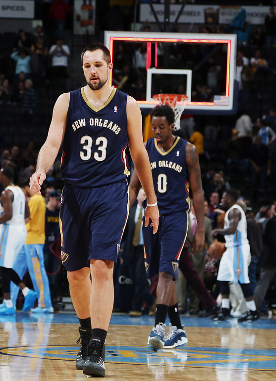 . New Orleans Pelicans forwards Ryan Anderson, front, and Al-Farouq Aminu heads off the court after the Denver Nuggets\' 102-93 victory over the Pelicans in an NBA basketball game in Denver on Sunday, Dec. 15, 2013. (AP Photo/David Zalubowski)