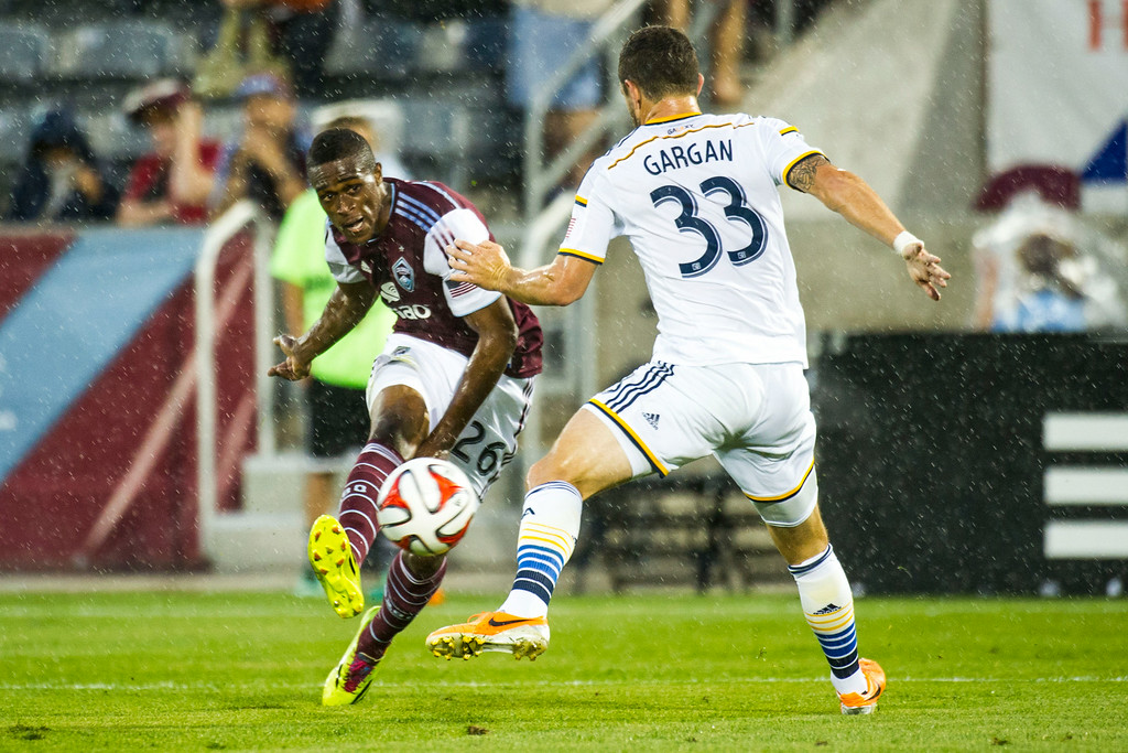 . COMMERCE CITY, CO - AUGUST 20:  Deshorn Brown (26) of Colorado Rapids kicks past Dan Gargan (33) of Los Angeles Galaxy during a Major League Soccer game at Dick\'s Sporting Goods Park on Wednesday, August 20, 2014 in Commerce City, Colorado.  Director Comey\'s visit to the Dick\'s Sporting Goods Park is part of his plan to visit all FBI Field Offices in his first year as director.  (Photo by Kent Nishimura/The Denver Post)