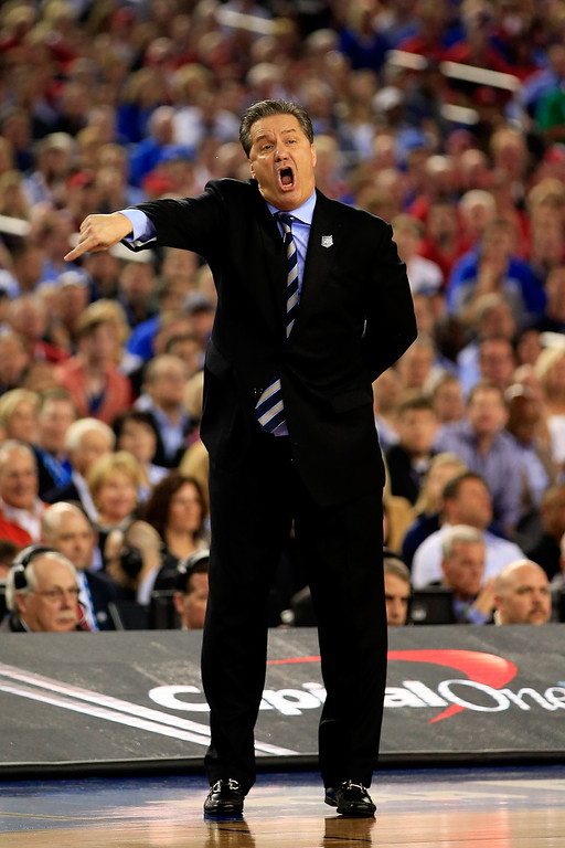 . ARLINGTON, TX - APRIL 07:  Head coach John Calipari of the Kentucky Wildcats calls to his players during the NCAA Men\'s Final Four Championship against the Connecticut Huskies at AT&T Stadium on April 7, 2014 in Arlington, Texas.  (Photo by Jamie Squire/Getty Images)