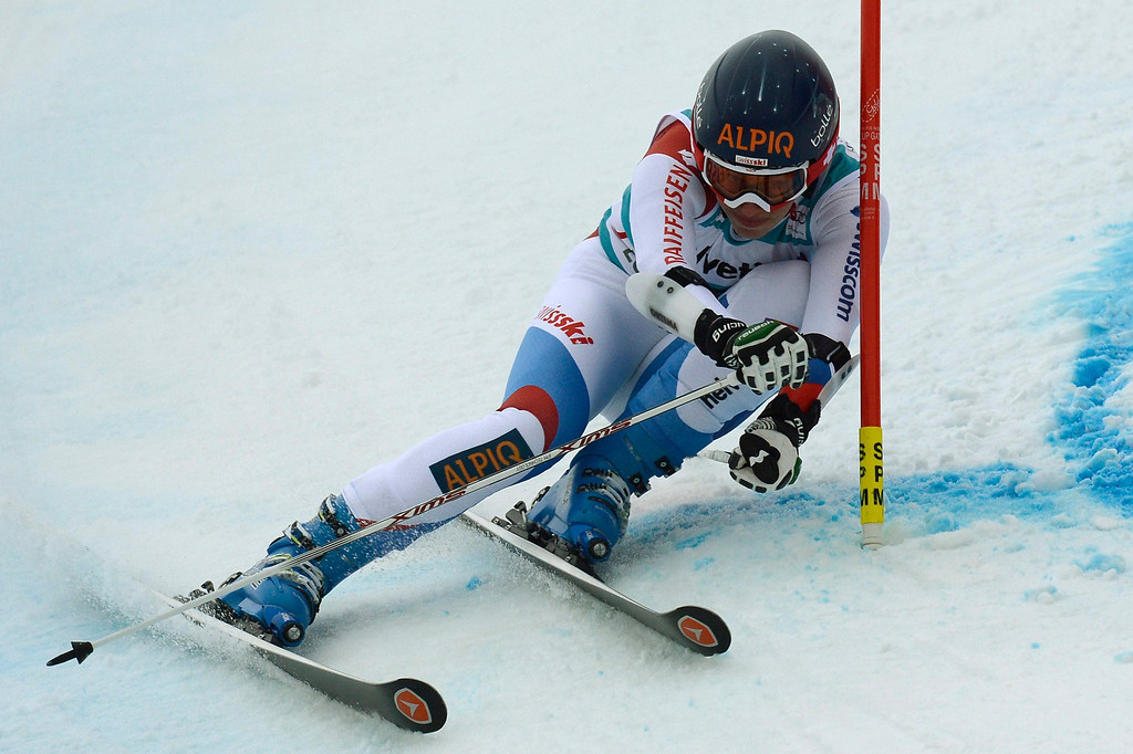 . Dominique Gisin of Switzerland speeds down the course in the first run during the women\'s Giant Slalom race at the FIS Alpine Skiing World Cup finals, in Parpan-Lenzerheide, Switzerland, 16 March 2014.  EPA/PETER SCHNEIDER
