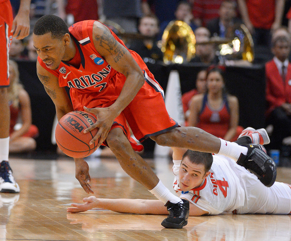 . Arizona\'s Mark Lyons, left, breaks clear of Ohio State\'s Aaron Craft during the second half of a West Regional semifinal in the NCAA men\'s college basketball tournament, Thursday, March 28, 2013, in Los Angeles. Ohio State won 73-70. (AP Photo/Mark J. Terrill)