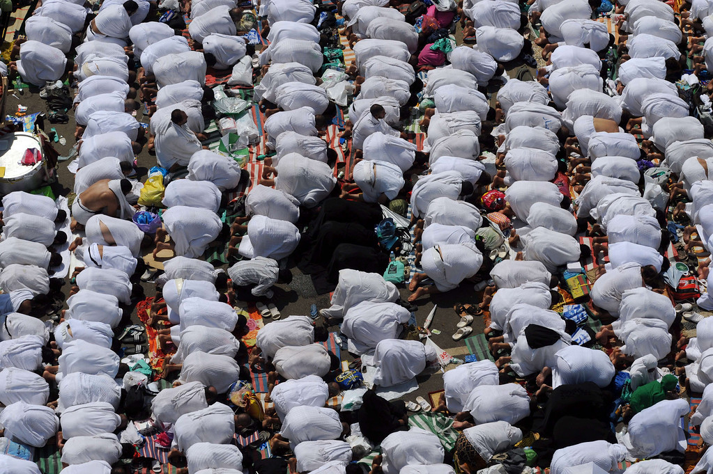 . Muslim hajj pilgrims perform noon prayers outside the Namira mosque near Mount Arafat on October 14, 2013. Some 1.5 million Muslim pilgrims thronged Mount Arafat in Saudi Arabia for the high point of the annual hajj, praying for an end to disputes and bloodshed.  AFP PHOTO/FAYEZ NURELDINE/AFP/Getty Images