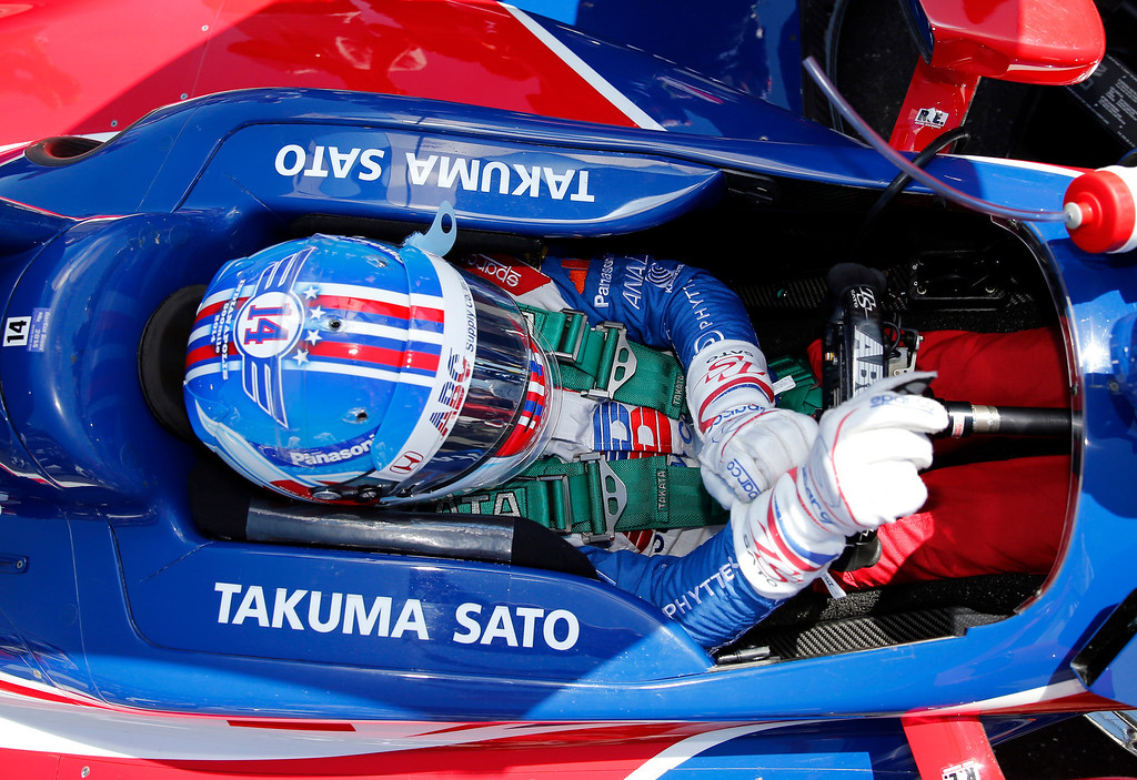 . Takuma Sato, of Japan, prepares to drive before the start of the 98th running of the Indianapolis 500 IndyCar auto race at the Indianapolis Motor Speedway in Indianapolis, Sunday, May 25, 2014. (AP Photo/Robert Baker)