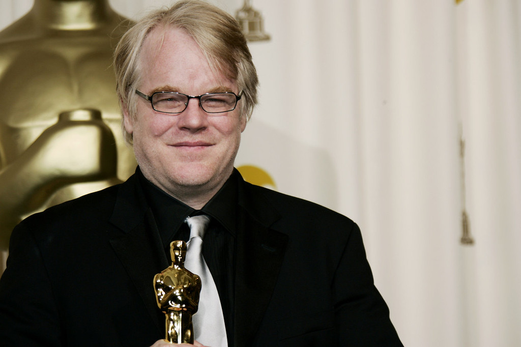 ". In a Sunday, March 5, 2006, file photo, actor Philip Seymour Hoffman poses with the Oscar he won for best actor for his work in ""Capote\"" at the 78th Academy Awards, in Los Angeles.   Police say  Hoffman has been found dead in his  apartment. (AP Photo/Kevork Djansezian, File)"