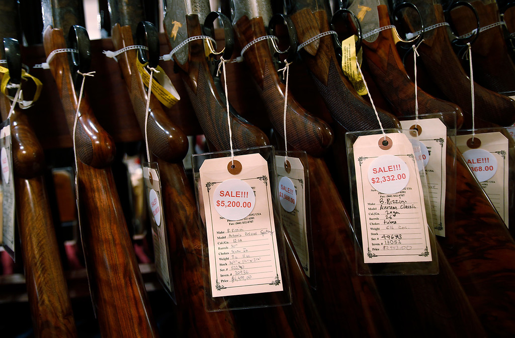 . A row of shotguns are seen during the East Coast Fine Arms Show in Stamford, Connecticut, January 5, 2013. REUTERS/Carlo Allegri