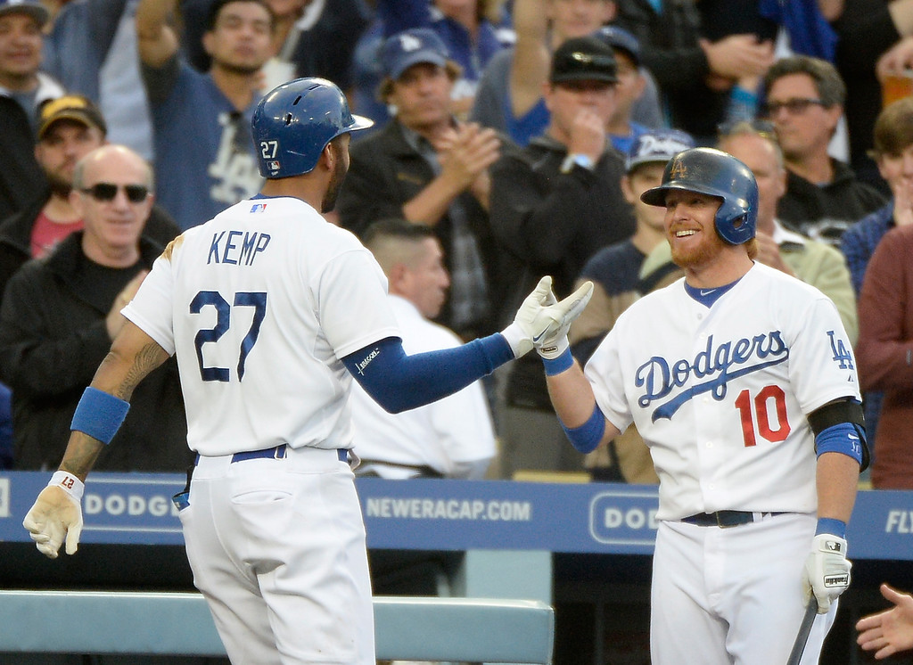 . LOS ANGELES, CA - APRIL 26:  Matt Kemp #27 of the Los Angeles Dodgers celebrates his homerun with Justin Turner #10 for a 3-1 lead over the Colorado Rockies during the third inning at Dodger Stadium on April 26, 2014 in Los Angeles, California.  (Photo by Harry How/Getty Images)