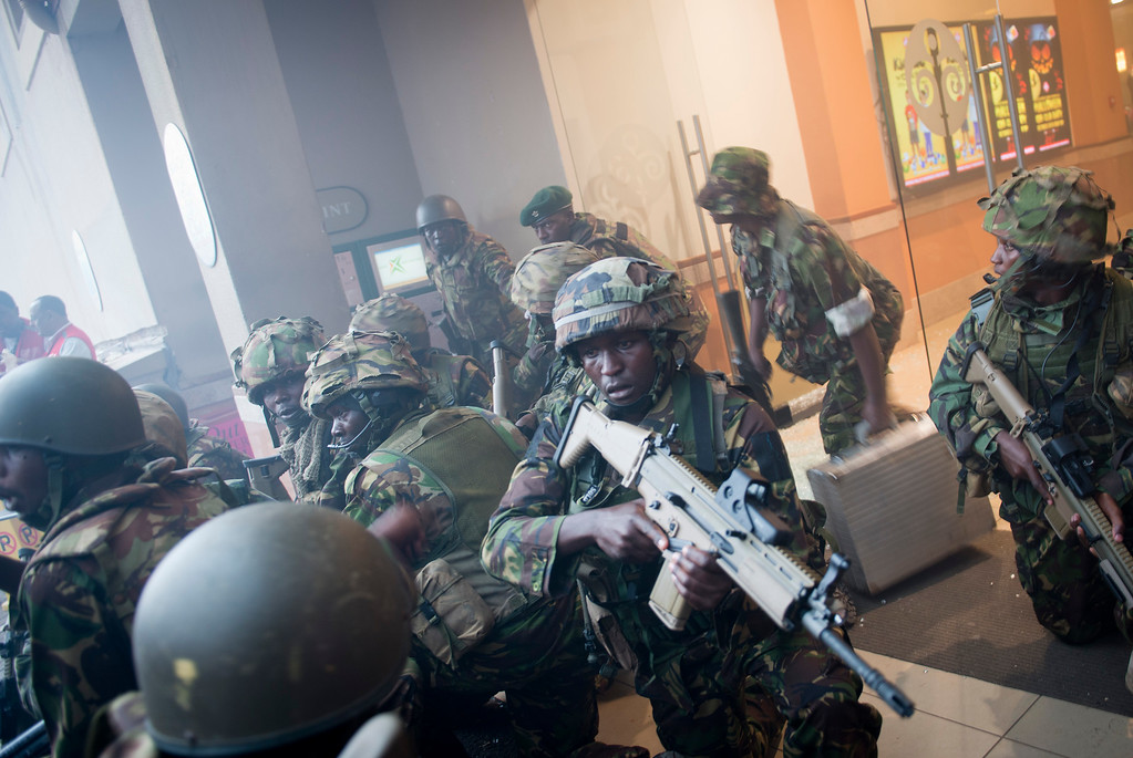 . Armed police leave after entering the Westgate Mall in Nairobi, Kenya Saturday, Sept. 21, 2013.  (AP Photo/Jonathan Kalan)