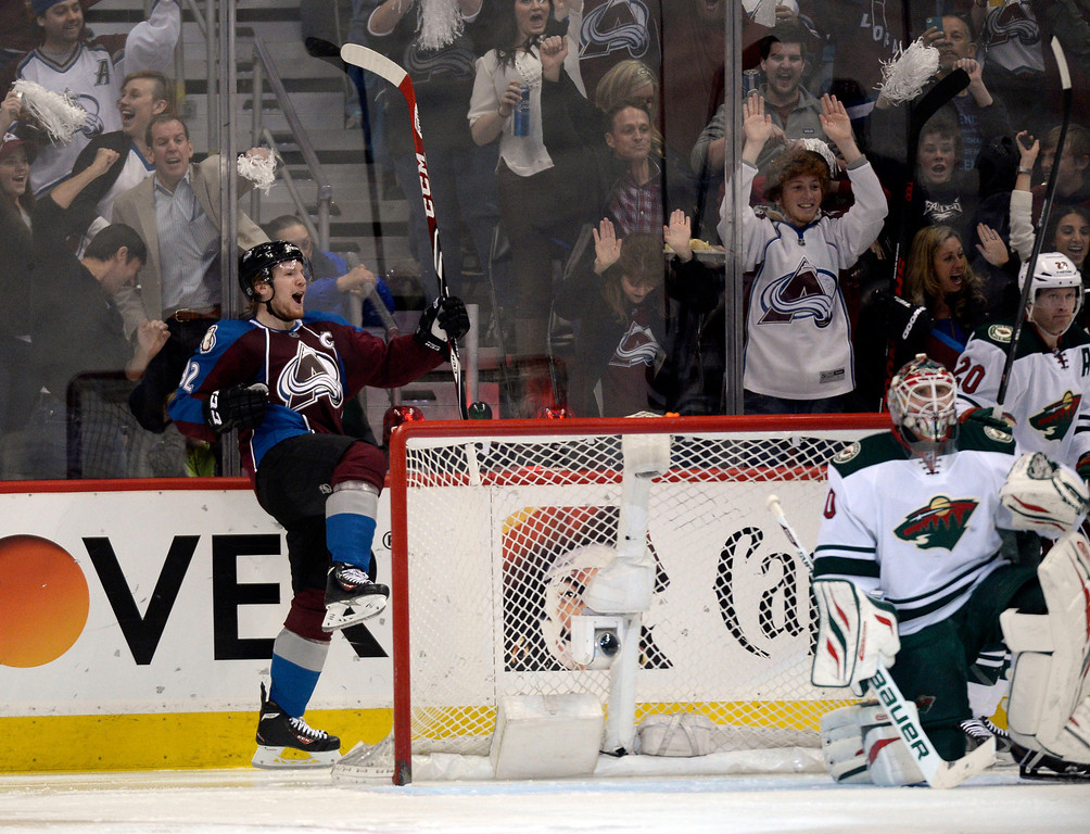. Gabriel Landeskog (92) of the Colorado Avalanche celebrates his first goal in the second period of action as goalie Ilya Bryzgalov (30) of the Minnesota Wild looks up at the scoreboard. (Photo by John Leyba/The Denver Post)