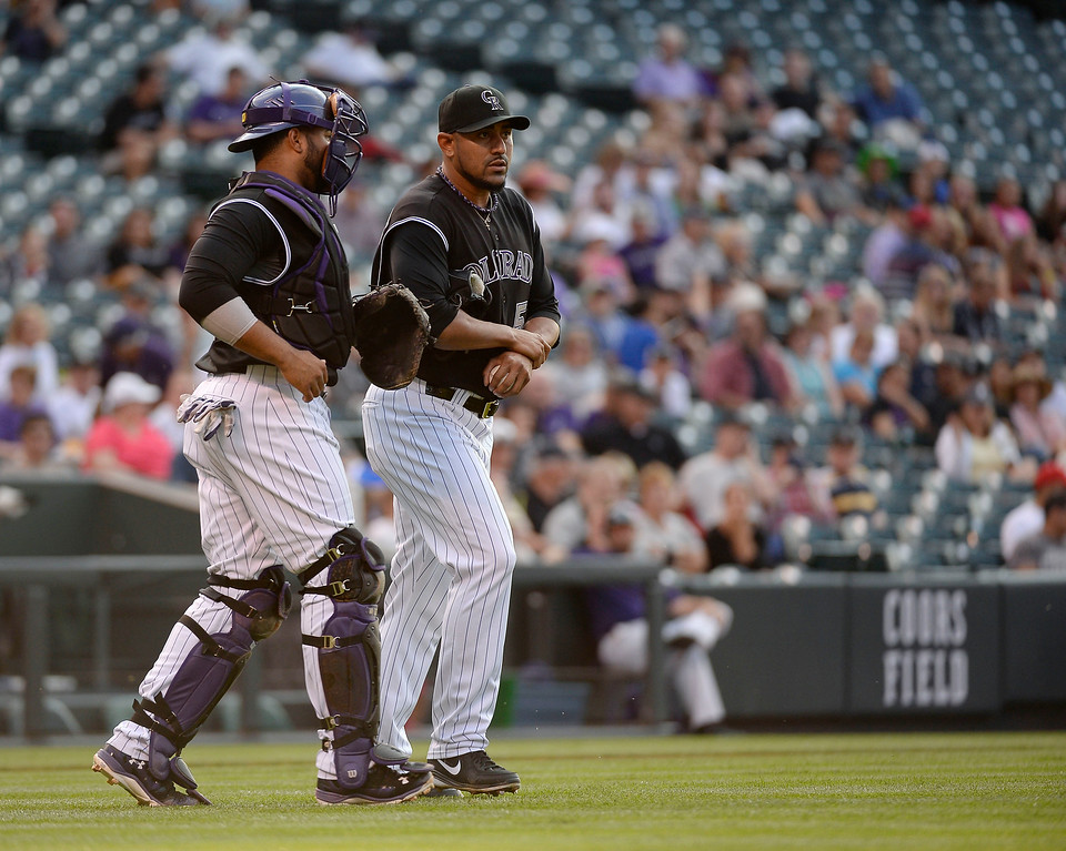 . Colorado Rockies catcher Wilin Rosario (20) comes out to talk with Colorado Rockies starting pitcher Franklin Morales (56) during the first inning against the San Diego Padres July 8, 2014 at Coors Field. (Photo by John Leyba/The Denver Post)