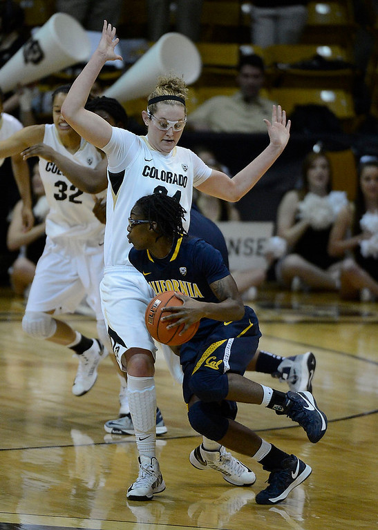 . California Golden Bears guard Eliza Pierre (4) drives on Colorado Buffaloes forward Jen Reese (34) during the second half Sunday, January 6, 2013 at Coors Events Center. John Leyba, The Denver Post