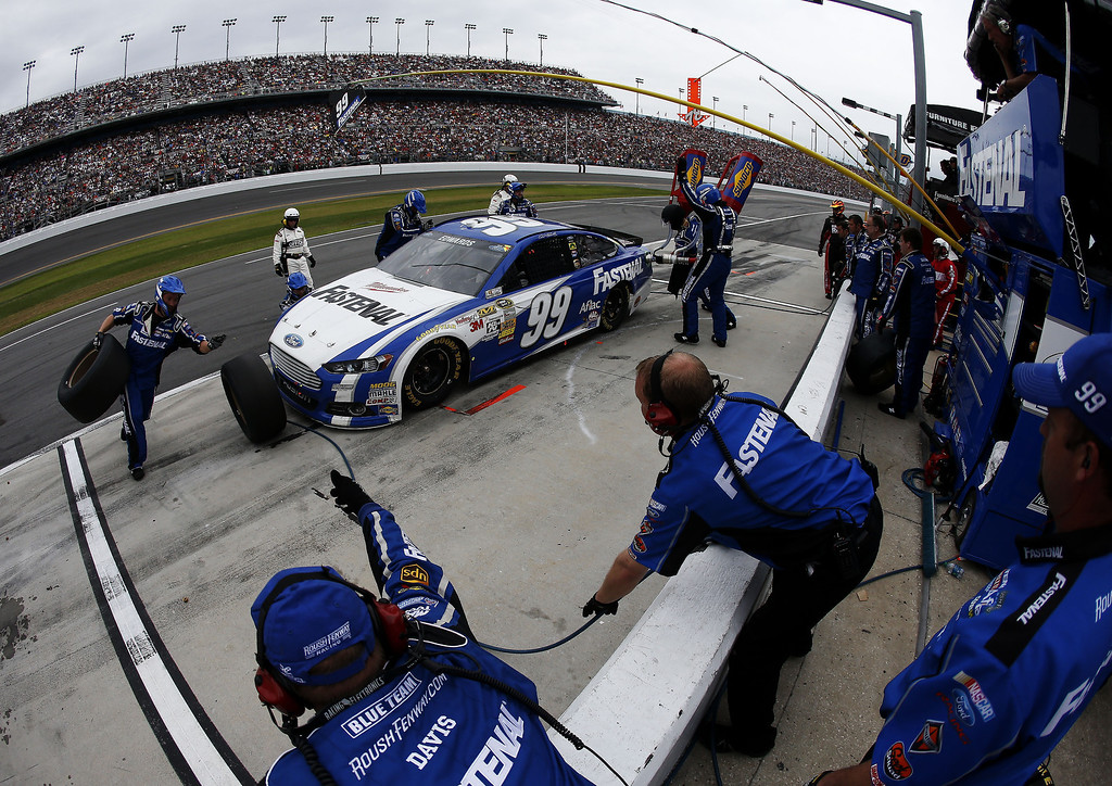 . Carl Edwards, driver of the #99 Fastenal Ford, pits during the NASCAR Sprint Cup Series Daytona 500 at Daytona International Speedway on February 24, 2013 in Daytona Beach, Florida.  (Photo by Chris Graythen/Getty Images)