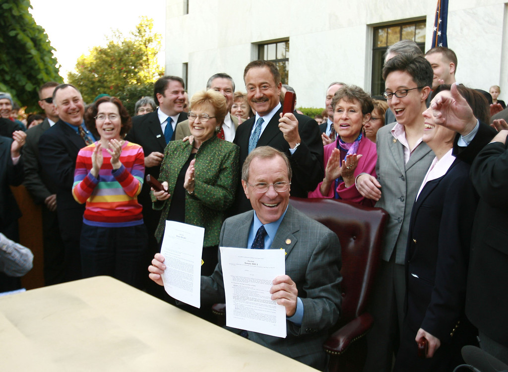. SALEM, OR - MAY 9:  Oregon Governor Ted Kulongoski (D) holds up two bills signed into law at the Oregon State Capital May 9, 2007 in Salem, OR. The Oregon Family Fairness Act, a bill that  creates a new statute in Oregon law that would legally recognize committed same-sex relationships as Domestic Partnerships and The Oregon Equality Act, a  non-discrimination bill that would prohibit discrimination in employment, housing and public accommodation, on the basis of sexual orientation. (Photo by Craig Mitchelldyer/Getty Images)