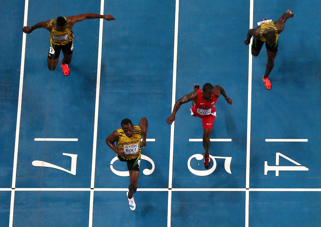 . Usain Bolt of Jamaica (C) crosses the line to win gold ahead of Kemar Bailey-Cole of Jamaica, Justin Gatlin of the United States and Nickel Ashmeade of Jamaica in the Men\'s 100 metres Final  during Day Two of the 14th IAAF World Athletics Championships Moscow 2013 at Luzhniki Stadium on August 11, 2013 in Moscow, Russia.  (Photo by Julian Finney/Getty Images)