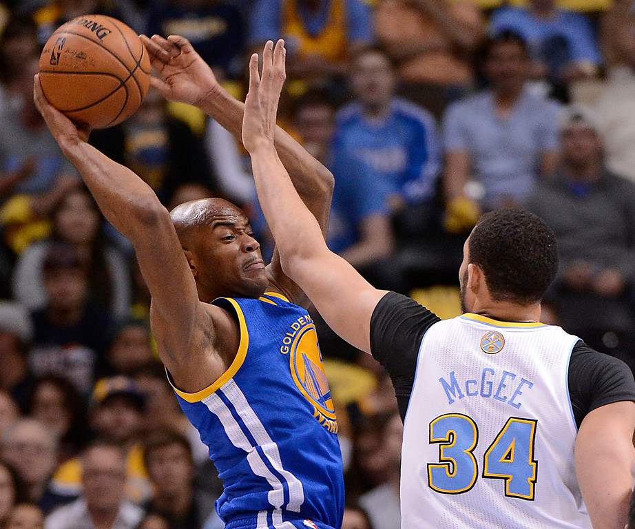 . Golden State Warriors point guard Jarrett Jack (2) looks to pass against Denver Nuggets center JaVale McGee (34) in the first quarter. The Denver Nuggets took on the Golden State Warriors in Game 5 of the Western Conference First Round Series at the Pepsi Center in Denver, Colo. on April 30, 2013. (Photo by John Leyba/The Denver Post)