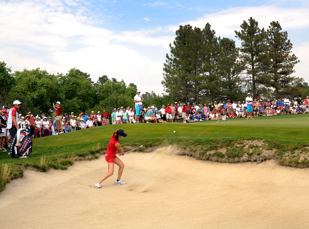 . PARKER, CO. - AUGUST 17: American golfer Michelle Wie chipped out of the bunker onto the 7th green Saturday at the Solheim Cup. It was the American Team versus the Europeans as play continued at the Colorado Golf Club Saturday afternoon, August 17, 2013. Photo By Karl Gehring/The Denver Post