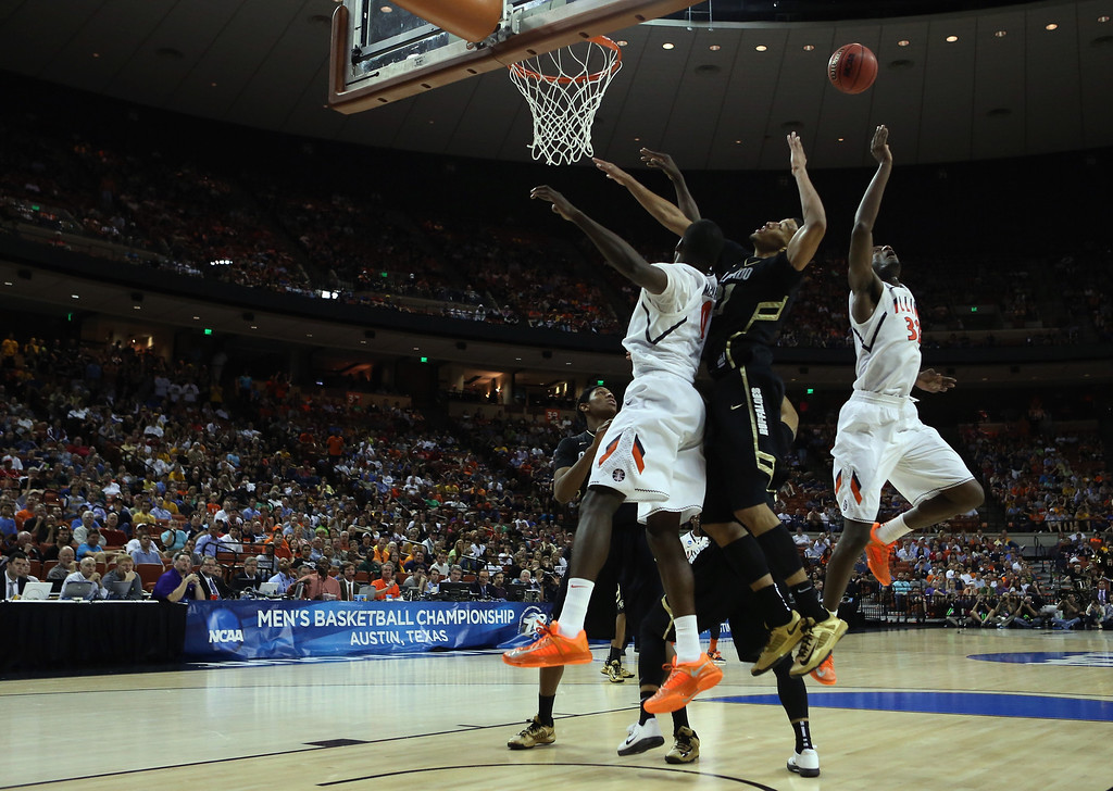 . AUSTIN, TX - MARCH 22:  Andre Roberson #21 of the Colorado Buffaloes gets caught up between Sam McLaurin #0 and Nnanna Egwu #32 of the Illinois Fighting Illini during the second round of the 2013 NCAA Men\'s Basketball Tournament at The Frank Erwin Center on March 22, 2013 in Austin, Texas.  (Photo by Ronald Martinez/Getty Images)