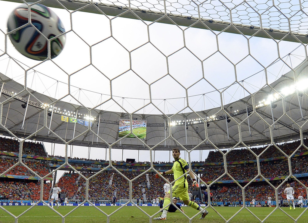 . Spain\'s goalkeeper Iker Casillas (R) fails to stop a ball shot by Netherlands\' forward Robin van Persie during a Group B football match between Spain and the Netherlands at the Fonte Nova Arena in Salvador during the 2014 FIFA World Cup on June 13, 2014. LLUIS GENE/AFP/Getty Images