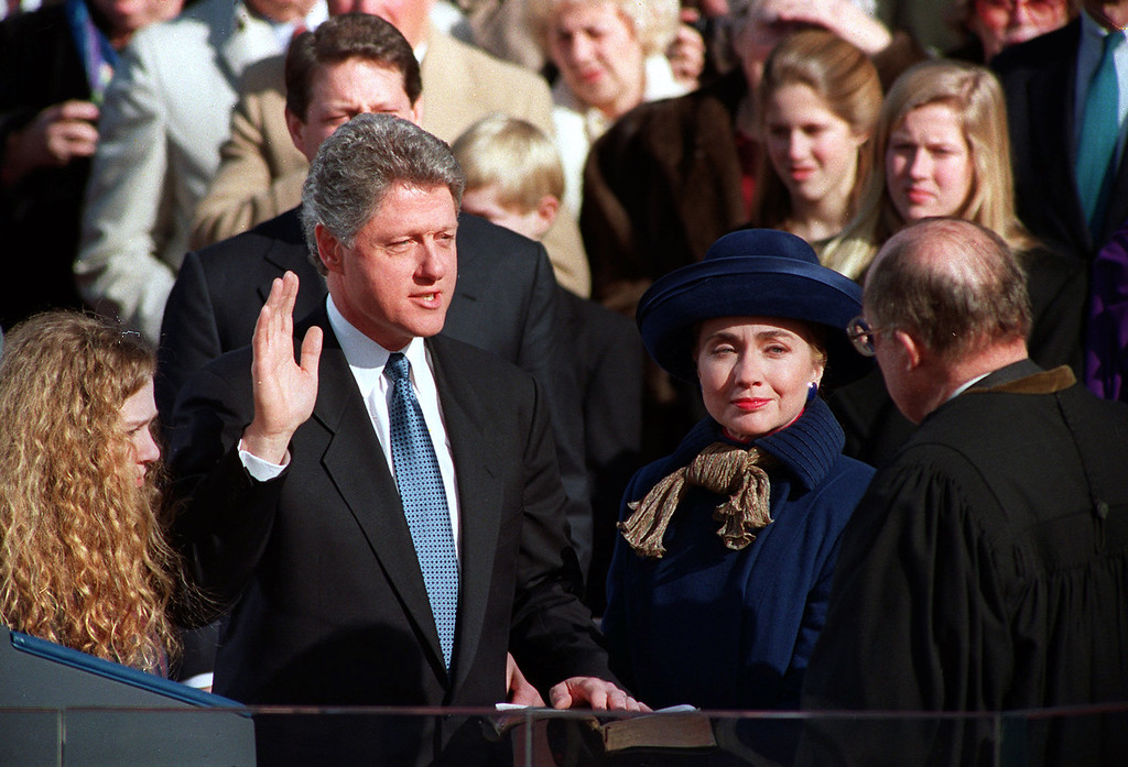 ". William Jefferson ""Bill\"" Clinton, with his wife Hillary Rodham Clinton and daughter Chelsea at his side, takes the oath of office as 42nd president of the United States from Chief Justice William H. Rehnquist on the west steps of the Capitol in Washington, Wednesday, Jan. 20, 1993. (AP Photo/Ed Reinke)"