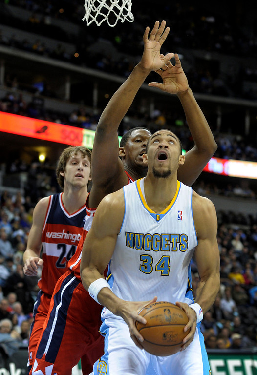 . DENVER, CO - JANUARY 18: Denver center JaVale McGee worked under the basket against Washington center Kevin Seraphin in the first half. The Denver Nuggets hosted the Washington Wizard at the Pepsi Center Friday night, January 18, 2013. Karl Gehring/The Denver Post