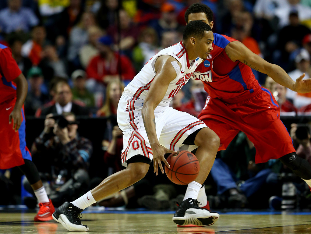 . LaQuinton Ross #10 of the Ohio State Buckeyes drives to the basket against the Dayton Flyers during the second round of the 2014 NCAA Men\'s Basketball Tournament at the First Niagara Center on March 20, 2014 in Buffalo, New York.  (Photo by Elsa/Getty Images)