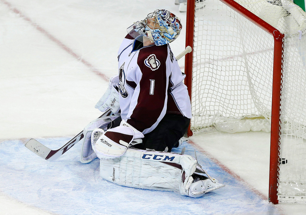 . Colorado Avalanche goalie Semyon Varlamov (1), of Russia, reacts after a puck shot by New York Rangers\' Brad Richards got past him for a goal during the third period of an NHL hockey game, Tuesday, Feb. 4, 2014, in New York. The Rangers won 5-1. (AP Photo/Frank Franklin II)