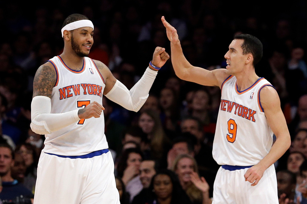 . New York Knicks\' Carmelo Anthony (7) celebrates with Pablo Prigioni (9) during the second half of an NBA basketball game against the Denver Nuggets on Friday, Feb. 7, 2014, in New York. The Knicks won 117-90. (AP Photo/Frank Franklin II)