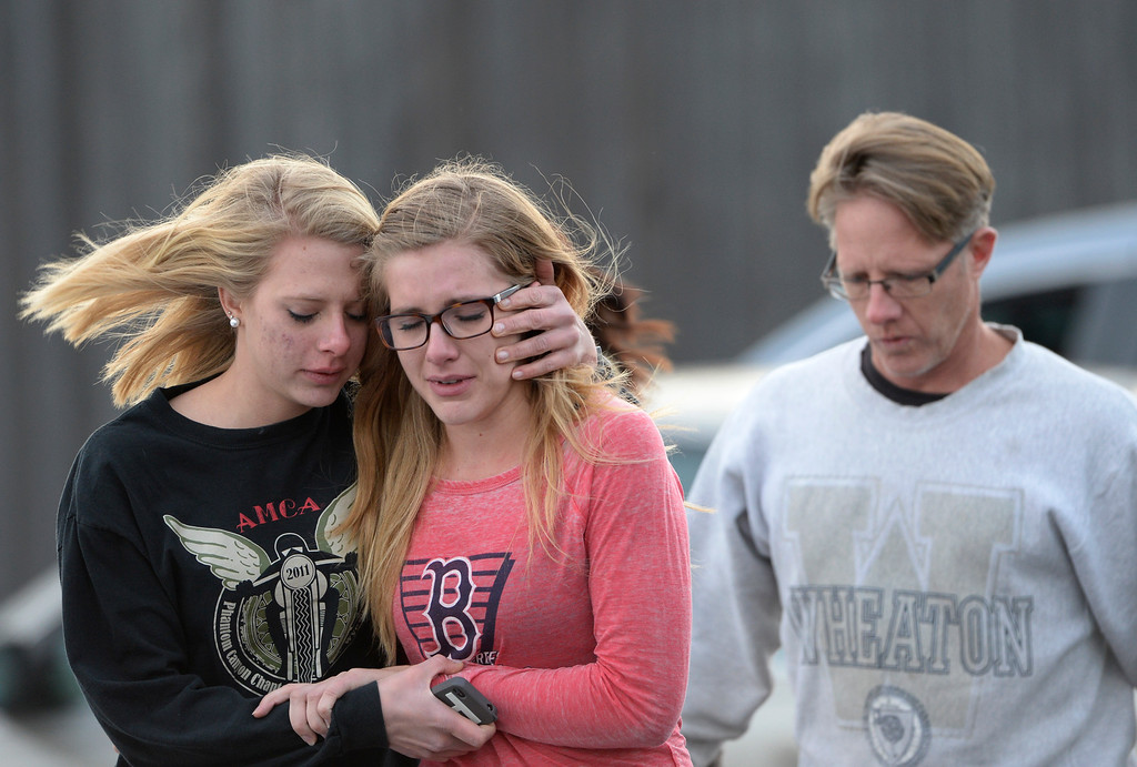 . CENTENNIAL, CO - DECEMBER 13: Students and their parents leave Shepherd of the Hills School where frightened parents pick up their children after a gunman opened fire at Arapahoe High School, December 13, 2013. One student was critically wounded. (Photo by RJ Sangosti/The Denver Post)