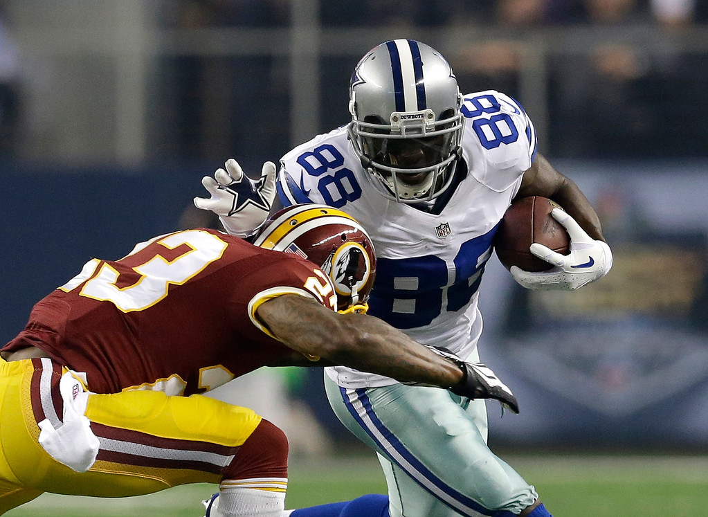 . Washington Redskins cornerback DeAngelo Hall (23) chases down an tackles Dallas Cowboys wide receiver Dez Bryant (88) in the first half of an NFL football game, Sunday, Oct. 13, 2013, in Arlington, Texas. (AP Photo/LM Otero)