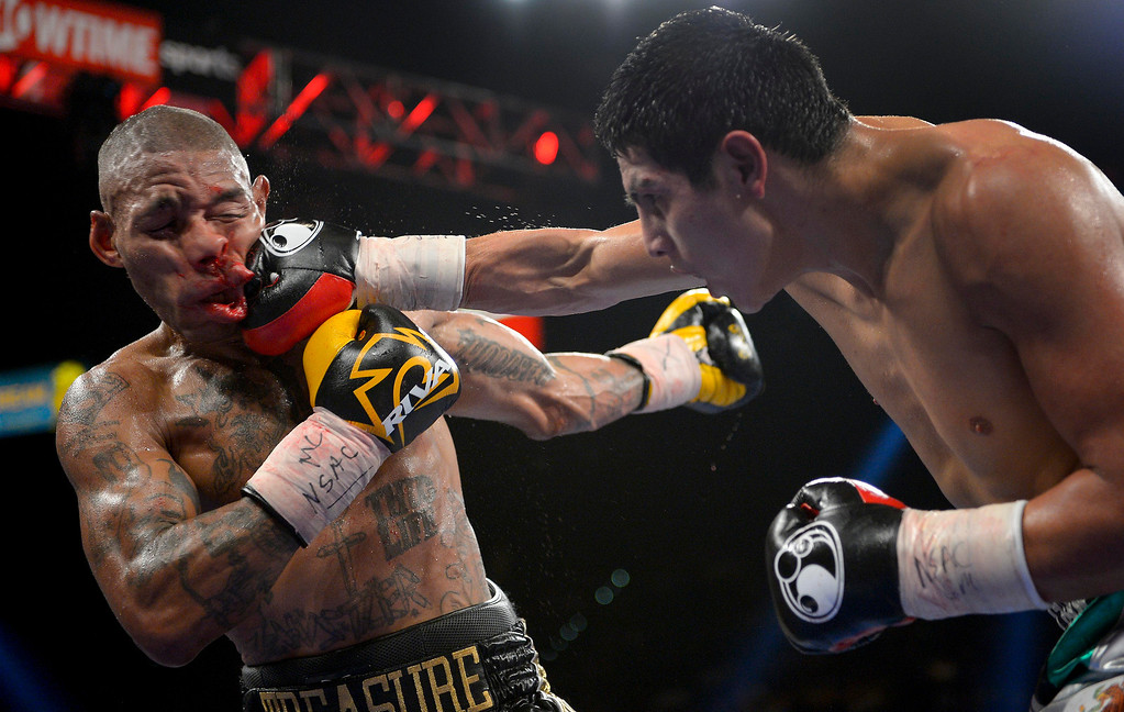 . Pablo Cesar Cano, right, lands a punch against Ashley Theophane in the eighth round during a welterweight fight, Saturday, Sept. 14, 2013, in Las Vegas. (AP Photo/Mark J. Terrill, File)