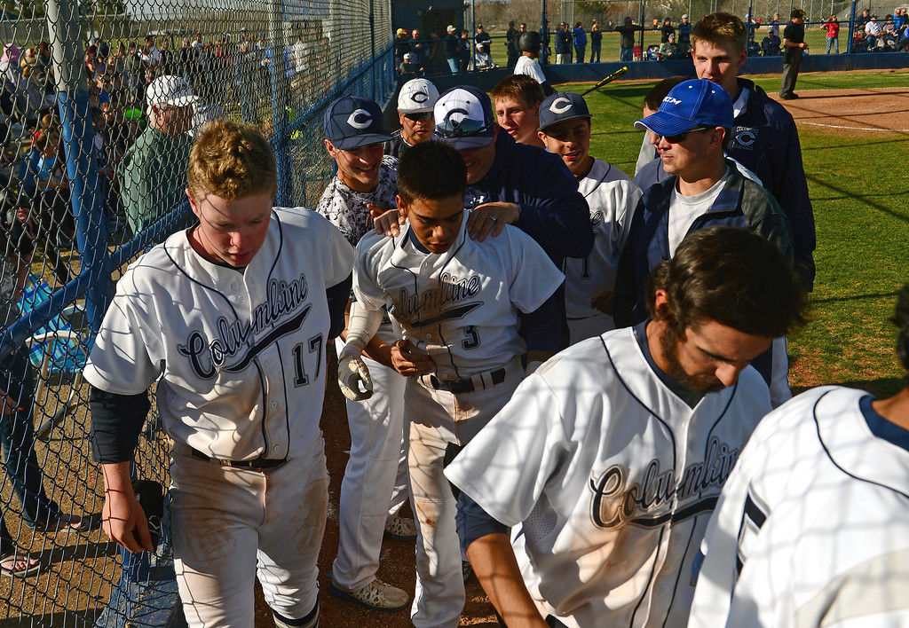 . LITTLETON, CO - APRIL 16,  2014: Columbine Rebels Donny Ortiz, #3, middle, is congratulated by his teammates after  his fourth inning home run  during their game against the Ralston Valley Mustangs at Columbine High School in Littleton, Co on April 17, 2014. Columbine pitcher Blake Weiman had a great game and was taken out in the fifth inning when the Rebels were up 8 to 1 over the Mustangs. (Photo By Helen H. Richardson/ The Denver Post)