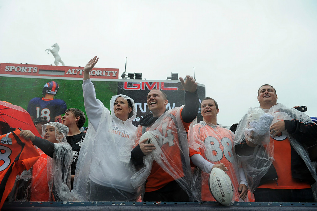 . Denver Broncos fans show up for practice despite the rain on day six of the Denver Broncos 2014 training camp July 30, 2014 at Sports Authority Field at Mile High Stadium.  (Photo by John Leyba/The Denver Post)