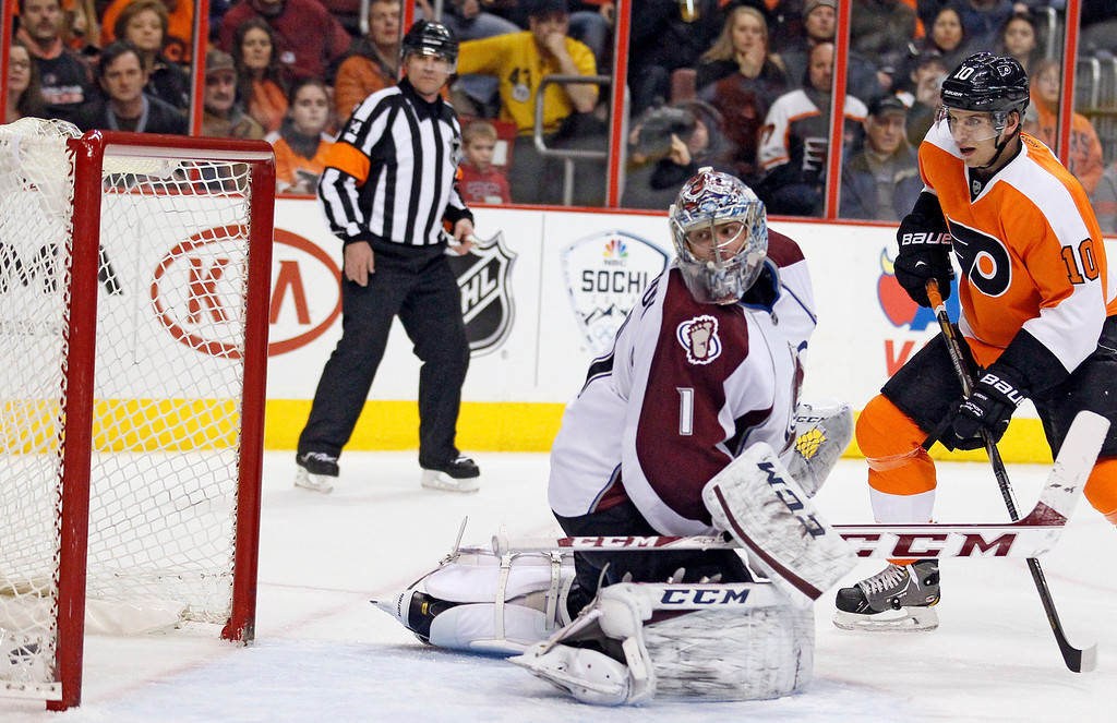 . Colorado Avalanche goalie Semyon Varlamov looks back at the puck in the net, lower left, shot by Philadelphia Flyers\' Mark Streit, not pictured, as Brayden Schenn, right, looks on during the second period of an NHL hockey game, Thursday, Feb. 6, 2014, in Philadelphia. (AP Photo/Tom Mihalek)
