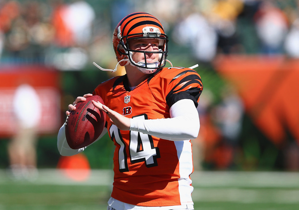 . Andy Dalton #14 of the Cincinnati Bengals throws a pass before the NFL game against the Green Bay Packers at Paul Brown Stadium on September 22, 2013 in Cincinnati, Ohio.  (Photo by Andy Lyons/Getty Images)