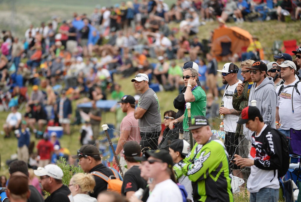 . People cheer the racers during 450 Class Moto #1 during the third round of the Lucas Oil Pro Motocross Championship at the mile high altitude of Thunder Valley MX Park. Lakewood, Colorado. June 07. 2014. (Photo by Hyoung Chang/The Denver Post)
