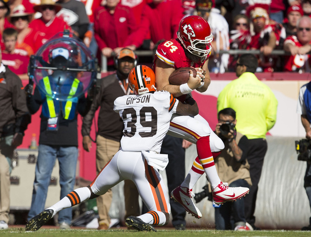 . Tight end Sean McGrath #84 of the Kansas City Chiefs is tackled by free safety Tashaun Gipson #39 of the Cleveland Browns after making a catch during the game at Arrowhead Stadium on October 27, 2013 in Kansas City, Missouri. (Photo by David Welker/Getty Images)