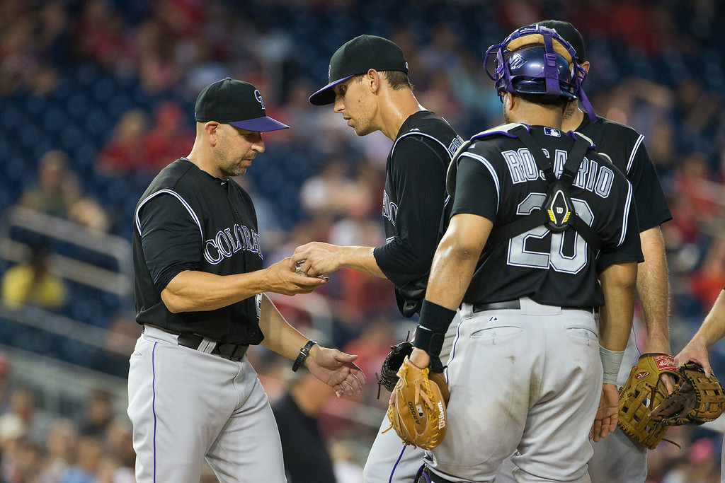 . Colorado Rockies manager Walt Weiss, left, pulls starting pitcher Christian Friedrich during the fourth inning of a baseball game against the Washington Nationals at Nationals Park, on Tuesday, July 1, 2014, in Washington. (AP Photo/ Evan Vucci)