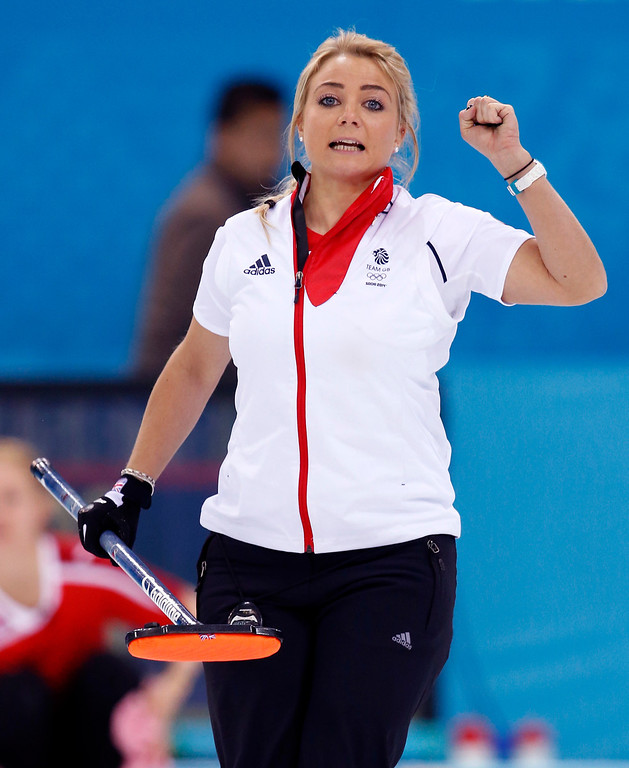 . Britain\'s Anna Sloan pumps her fist after a good throw during women\'s curling competition against Denmark  at the 2014 Winter Olympics, Monday, Feb. 17, 2014, in Sochi, Russia. (AP Photo/Robert F. Bukaty)