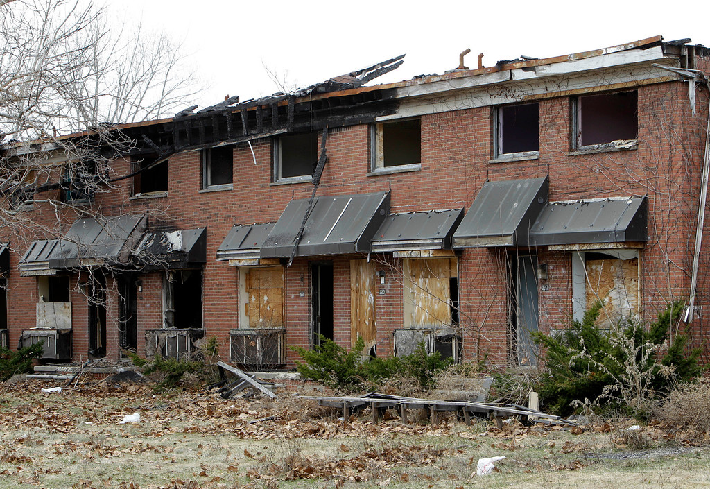 ". Part of the Brewster-Douglass housing project site is shown in Detroit, Friday, March 18, 2011.  If Detroit Housing Commission director Eugene Jones  had his way the ""for sale\"" sign he\'d post off Interstates 75 and 375 would read: \""14 acres of prime real estate between the city\'s resurgent downtown and promising Midtown. A steal at $9 million. Will accept reasonable offer.\"" Real offers have been few. One arts group proposal to hang junked cars from windows in one the Brewster-Douglass housing project\'s empty 14-story towers was declined. Unlike cities like Chicago, where the last building in notorious Cabrini-Green public housing complex was razed within months of the final family moving out, Brewster-Douglass has been empty for two years and none of the 20 brick buildings has been torn down. Neither the city nor Jones\' commission has the money to demolish the complex which is beginning to rival the long-empty, 17-story Michigan Central Depot as another symbol of Detroit\'s decay. (AP Photo/Paul Sancya)"