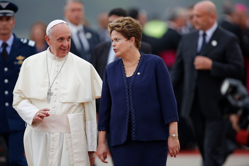 . Brazil\'s President Dilma Rousseff talks to Pope Francis as she accompanies him upon his arrival at the international airport in Rio de Janeiro, Brazil, Monday, July 22, 2013.  (AP Photo/Jorge Saenz)