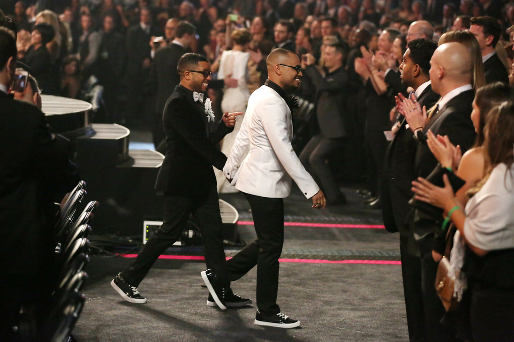 ". Audience members participate in a same sex wedding during a performance of ""Same Love\"" by Macklemore and Ryan Lewis at the 56th annual Grammy Awards at Staples Center on Sunday, Jan. 26, 2014, in Los Angeles. With Queen Latifah presiding from the stage and the music playing, 33 straight and gay couples lined the aisle dressed in wedding finery. Under Latifah\'s command, they exchanged rings near the end of Sunday night\'s show televised on CBS. (Photo by Matt Sayles/Invision/AP)"